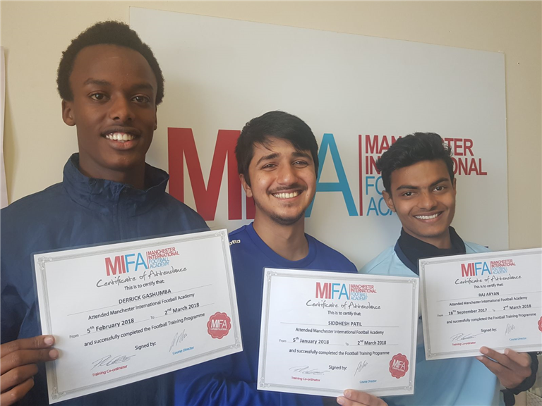 Derrick, Siddesh and Raj holding their certificates